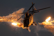 Military Helicopter Firing Fla...