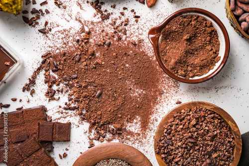 Fotomural  Cocoa beans pods, chocolate bar pieces, cocoa powder