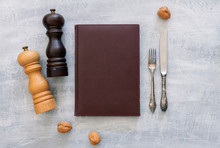 Vintage Leather Menu With Rustic Steel Or Metal Silverware With Copy Space. Top View Or Above View Composition