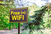 Free Wi-Fi Signpost In Yellow ...