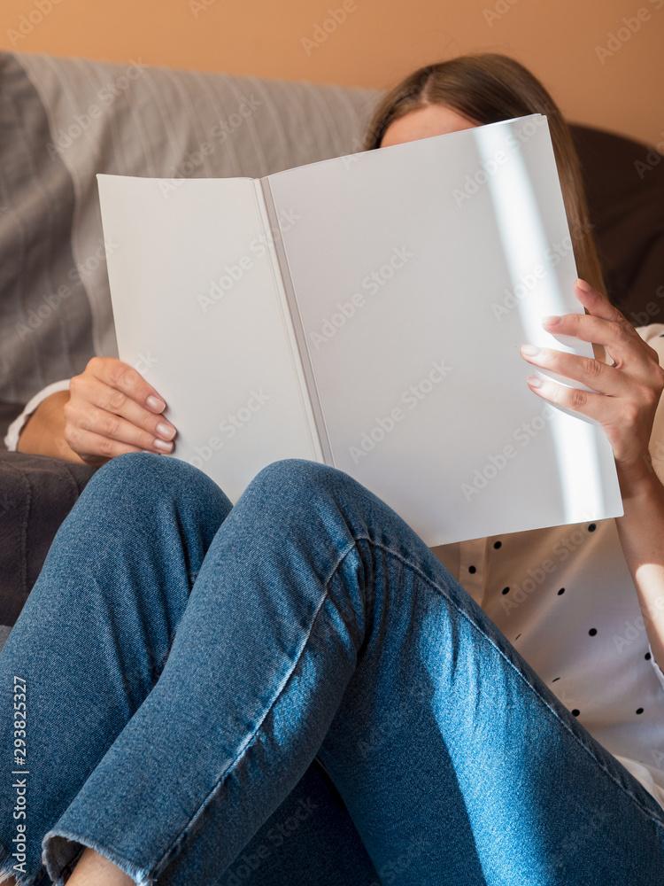 Fototapety, obrazy: Woman reading a mock-up magazine