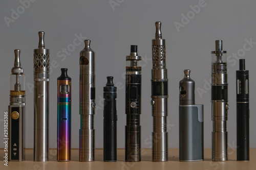 Fotomural  Collection of e-cigarettes or electronic cigarettes for liquid and vaping are di