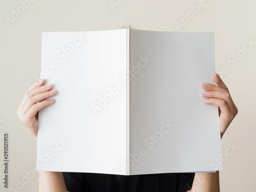 Obraz na plátně Mock-up magazine held by a woman