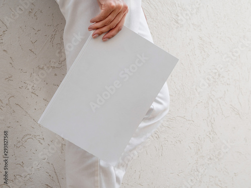 Fotografering  Woman holding a mock-up magazine