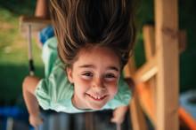 Upside Down Photo Of Girl Sitting On Swing