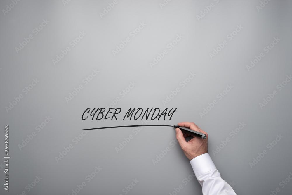 Fototapeta Male hand writing a Cyber monday sign