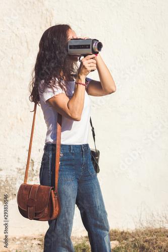 Obraz na plátne Movie maker working with old 8 mm film camera
