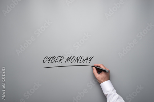 Male hand writing a Cyber monday sign