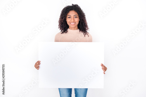 Obraz Portrait of black woman holding white banner isolated - fototapety do salonu