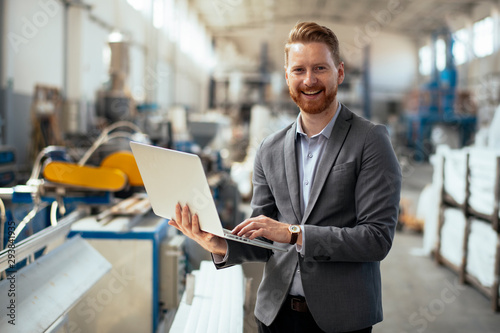 Fototapety, obrazy: Manager checks machines at the factory. Inspector checks a factory.