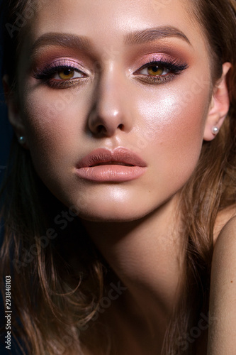 Obraz Close up portrait of beautiful young woman with professional makeup, perfect skin, colorful eyeshadows. - fototapety do salonu