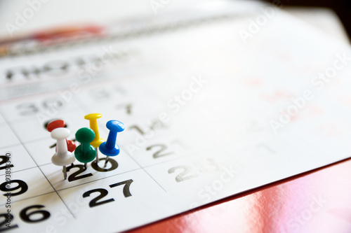 Fototapeta Thumbtack in calendar concept for important date or busy day, appointment and meeting reminder. Pushpin with busy day overworked schedule. obraz na płótnie