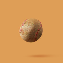 Baseball Ball Made From Kiwi Isolated On Light Brown Background