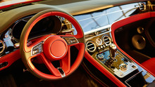Red Luxury Car Interior. Steer...