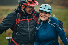 Mature Couple Smiling After A Mountain Bike Ride Together