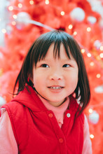 Asian Little Girl Playing With Christmas Tree Background