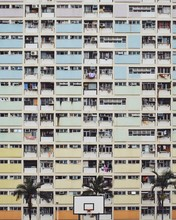 A Colorful Rainbow Apartment Building Above A Basketball Court In Rural Hong Kong