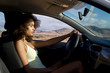 young woman driving in car