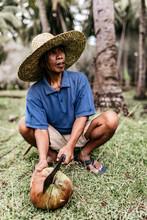 Asian Man Hacking Coconut