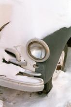 Retro Car Covered In Snow