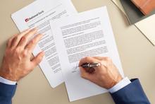 Crop Businessman Signing Paper