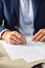 Contemporary Elegant Businessman Signing Document
