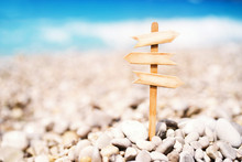Wooden Pointer, Board With Space For Your Text Against The Sea, Soft Focus. Vacation Background