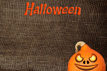 Halloween Symbol, Pumpkin On A Natural Canvas Background, Burlap With A Large Weave, Background And Texture, Close-up, Copy Space