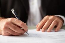 Faceless Man Putting Signature