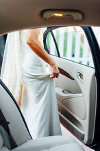 Bride Getting Into In Her Wedd...