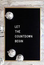 Board Letter Saying Let The Countdown Begin And Silver Disco Balls