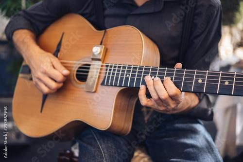 guitar man playing acoustic guitar  - 293862946