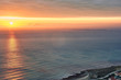 Landscape photography in which a winter sunrise is seen in the Mediterranean Sea from the coast of Alicante. Ideal for backgrounds. Space for text and presentations.