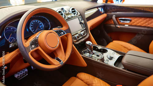 obraz lub plakat Brown leather interior of a luxury car