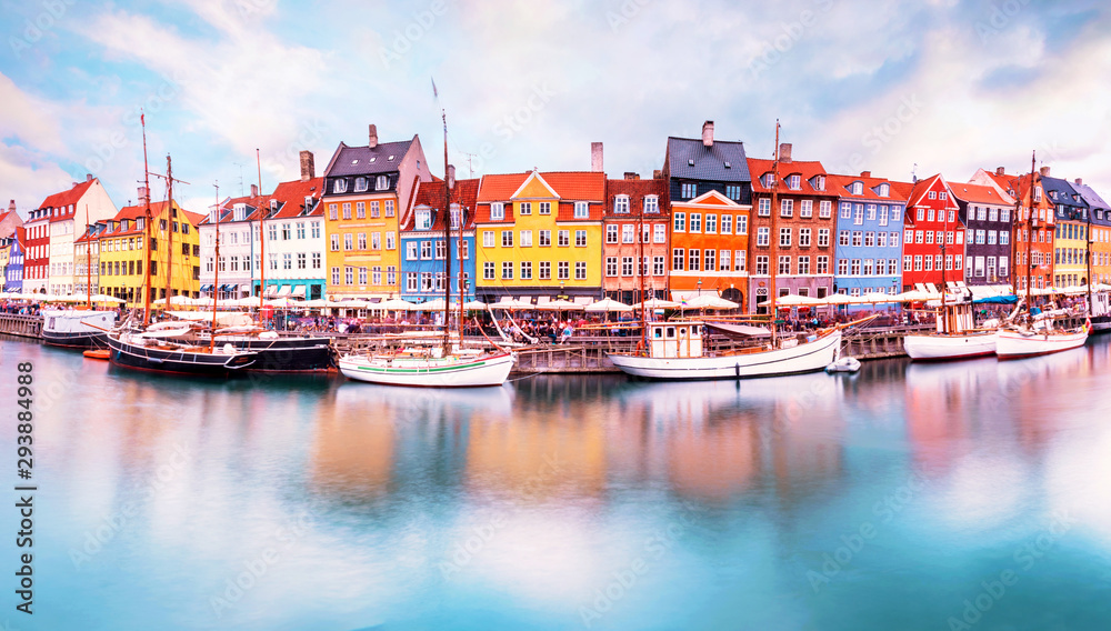 Fototapeta Unmatched magical fascinating landscape with boats in a famous Nyhavn in the capital of Denmark Copenhagen. Exotic amazing places. Popular tourist atraction.