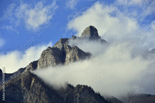 Clouds partially obscuring peak of cascade mountain in Banff national park, Canada.