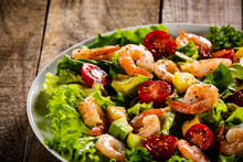 Salad With Shrimps On Wooden Background