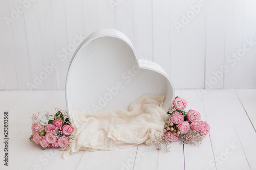 Obraz heart of wood decorated with roses. basket for newborn photo shoot. pink rose. heart - fototapety do salonu