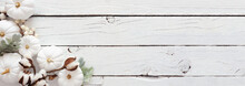 Autumn Corner Border Banner Of White Pumpkins And Silver Leaves Over A Rustic White Wood Background. Top View With Copy Space.
