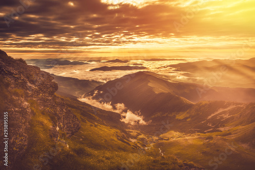Fotografie, Obraz  Very beautiful mountain landscape with mist rolling over the peaks