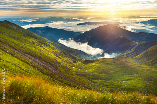Fototapeta  Very beautiful mountain landscape with mist rolling over the peaks