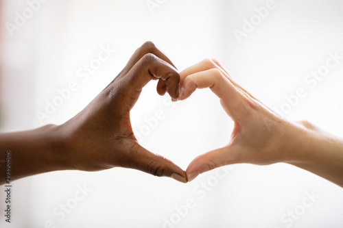 Valokuva  Multiracial Female Friend's Hands Showing Heart Shape