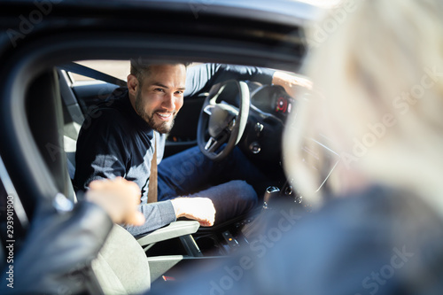 Fotografie, Obraz Happy Man Sitting In Car Looking Out