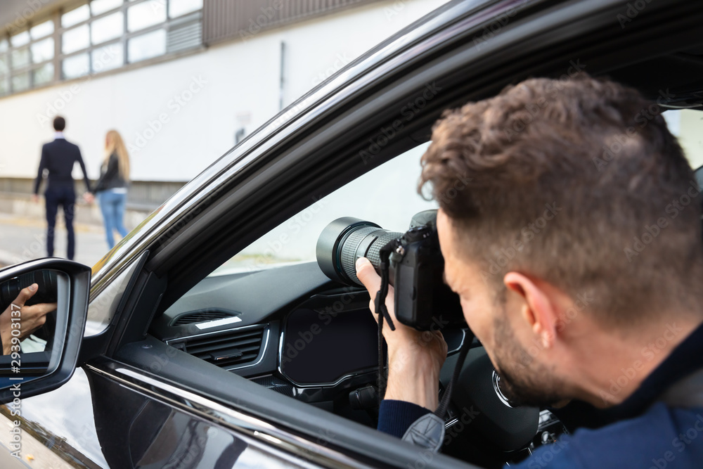Fototapety, obrazy: Private Detective Taking Photos Of Man And Woman