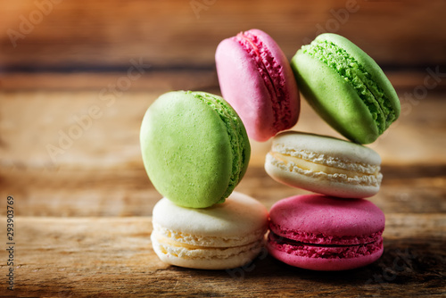 Fotobehang Macarons Multicoloured macarons on a dark wood background
