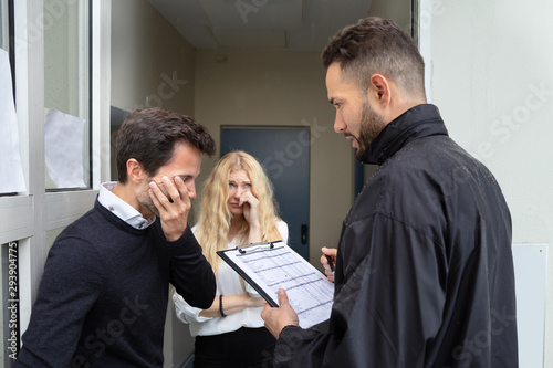 Photo Bailiff Talking With Sad Couple
