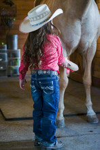 Little Cowgirl Grooming And Loving On Her Quarter Horse
