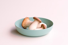 Three King Trumpet Mushrooms (also Known As French Horn Mushrooms, King Oyster Mushrooms Or Erring) In A Bowl Isolated On A White Background.