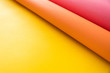 Leinwanddruck Bild - Pink and orange papers bending together over yellow color paper in abstract form. Abstract color paper background with copy space.