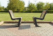 Two Benches Facing Each Other In The Garden